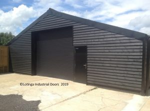 brown-roller-shutter-on-barn-min-300x222 Roller Shutters / Roller Doors