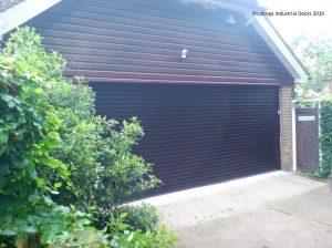 brown-roller-shutter-on-garage-C-min-300x224 Roller Shutter Garage Doors