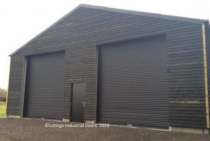 roller-shutter-on-barn-with-personnel-door-min-300x202 Sectors