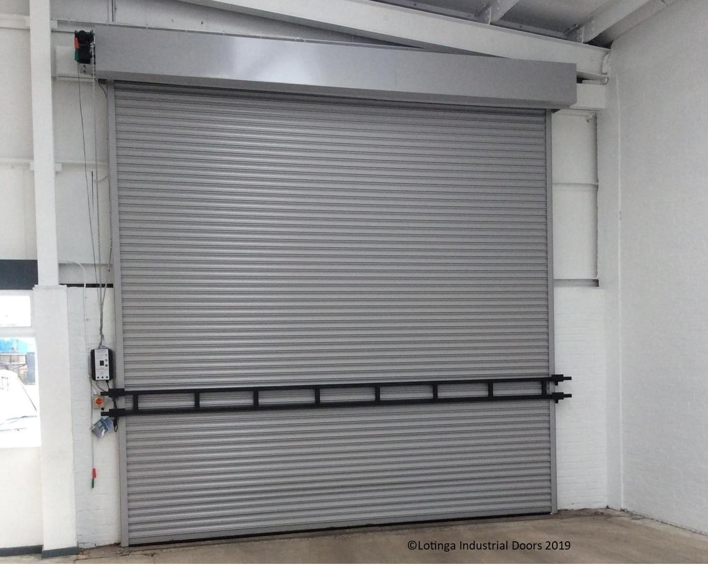 storm-bar-on-shutter-C-min PVC Strip Curtains, Doors and Barriers