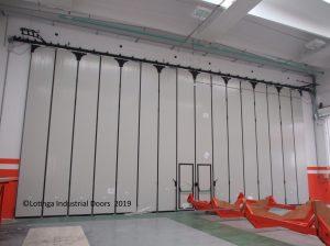 white-folding-concertina-doors-min-300x224 Industrial Bi-Folding Door