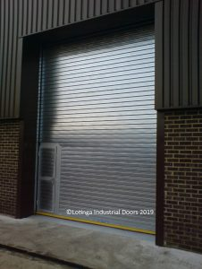 Galvanised-Industrial-Shutter-with-Wicket-Gate-min-226x300 Electric Shutters