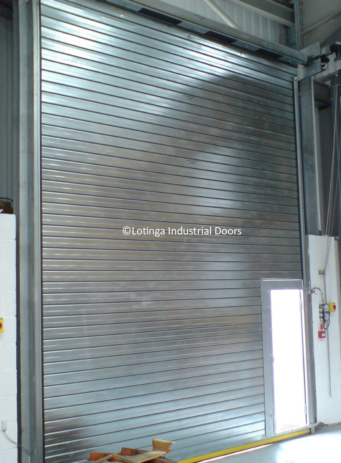 insulated-electric-shutter-with-wicket-gate-min Roller Shutters / Roller Doors